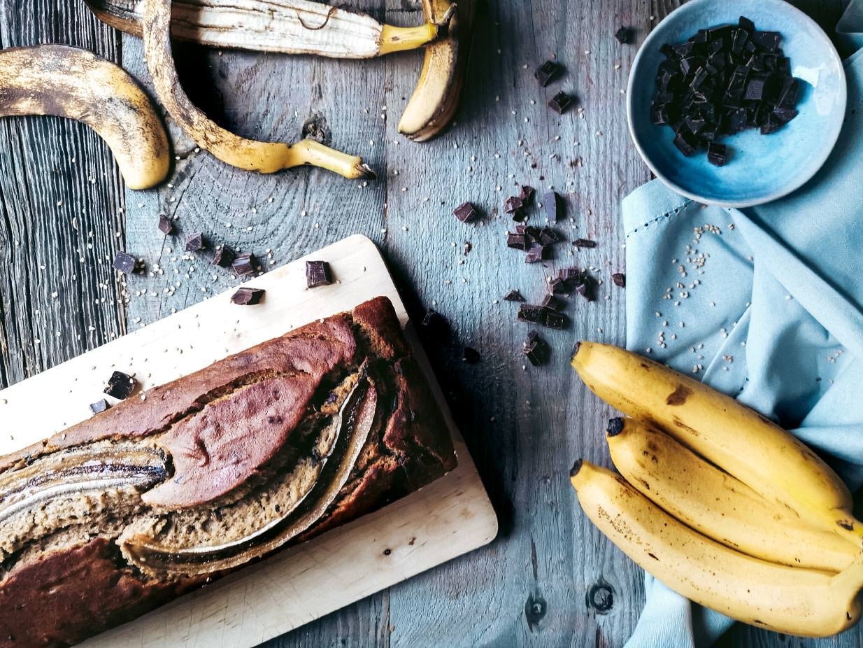 You can never have enough amazing vegan Banana Bread recipes. And this one's a keeper. A crunchy sesame crust, loads of vegan chocolate and yummy banana. The ultimate Banana Bread recipe.