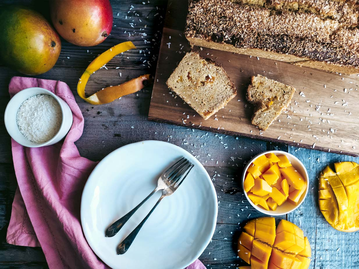 Tropical sunshine on a plate. That's exactly what this vegan Mango Coconut Loaf tastes like. The mango adds sweetness and moisture, the coconut delivers that beloved tropical taste. Gluten-free and sweetened with birch sugar.