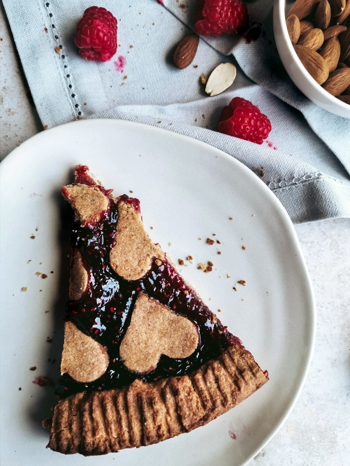 This famous Austrian dessert is the first tart my Grandma ever made for me - as far as I remember. The crumbly base and its rich, fruity raspberry filling is just perfection. This vegan & gluten-free adaption tastes just as good as the original and it's sweetened with birch sugar, a healthier spin on that cake classic.