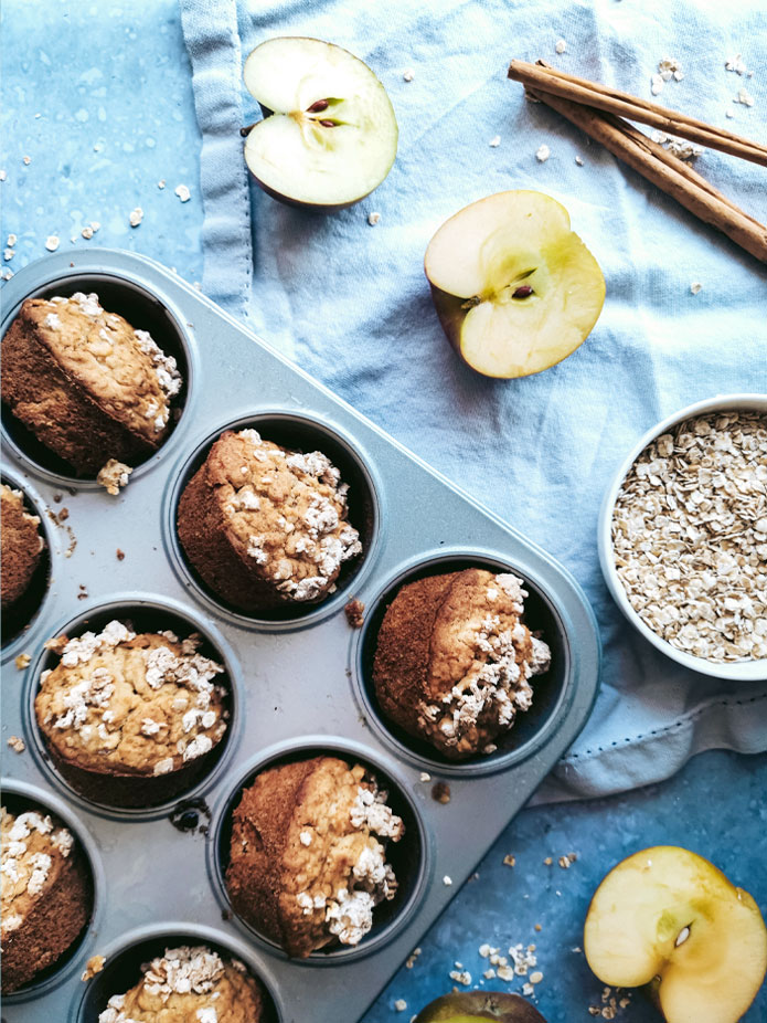 These vegan and gluten-free Apple Oatmeal Muffins are perfect for a quick breakfast on a busy day. Grab and go. A light and airy muffin with apples spiced with cinnamon, ginger and cardamom topped with crunchy oatmeal streusel. Naturally sweetened with apple, maple syrup and birch sugar.